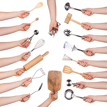 Woman holding kitchen utensils isolated on white background Stockfoto