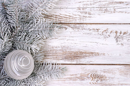 silver balls: Christmas decoration with fir, snow and white, wooden background Stock Photo