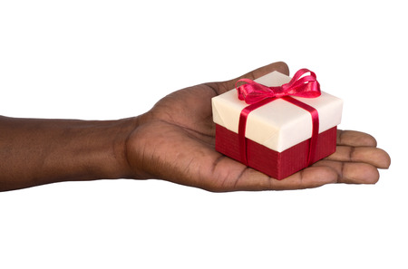 gift giving: Man holding a gift box in hand isolated on white background Stock Photo
