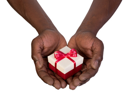 Man holding a gift box in hands isolated on white background Stock Photo