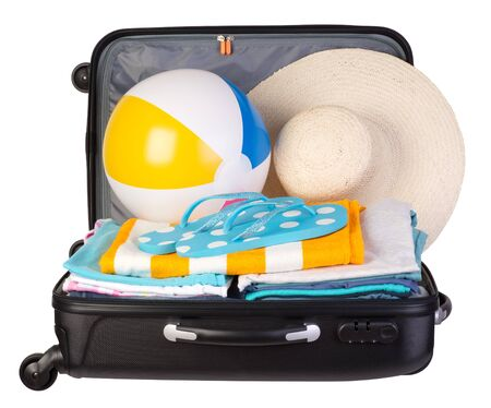 packed: Packed suitcase full of vacation items isolated on white