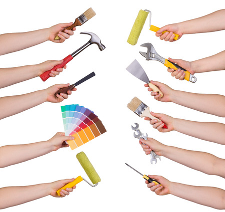 Woman holding redecorating tools isolated on white Stockfoto