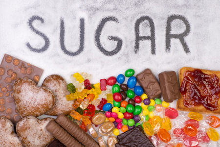 unhealthy diet: Food containing sugar. Too much sugar in diet causes obesity, diabetes and other health problems