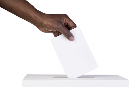 Ballot box with person casting vote on blank voting slip