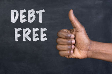 liquidity: Male hand giving the thumbs up gesture to the phrase Debt Free written on a blackboard