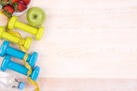 Fitness equipment on wooden background with copy space Stock Photo