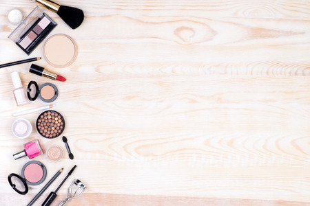 cosmetic product: Makeup cosmetics on white, wooden background with copy space, top view
