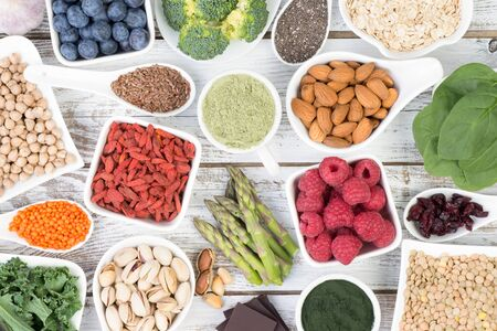 Healthy food called super foods on white, wooden background, top view Stock Photo