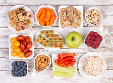 Healthy snacks on wooden table, top view 스톡 콘텐츠