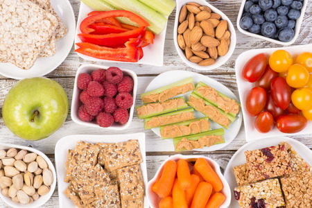 Healthy snacks on wooden table, top view Stockfoto