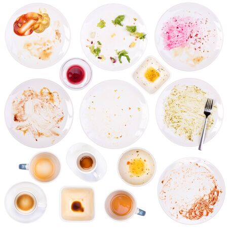dirty: Dirty plates and cups after a meal isolated on white background