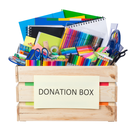 Stationary supplies donations box isolated on white background Archivio Fotografico