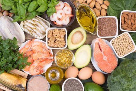 Food sources of Omega 3 fatty acids such as grains, fruit, vegetables and fish, top view
