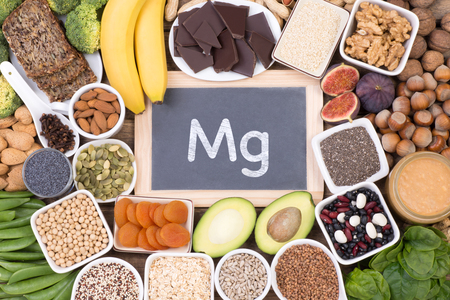 Various magnesium food sources such as grains, fruit, vegetables and chocolate, top view Zdjęcie Seryjne