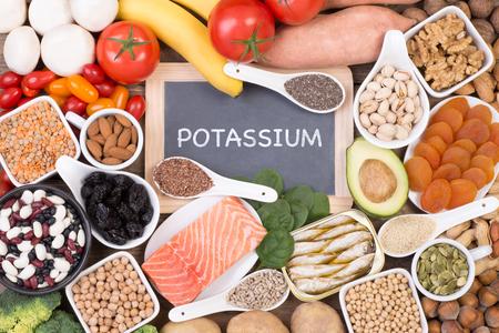 Various potassium food sources such as grains, fruit and  vegetables, top view