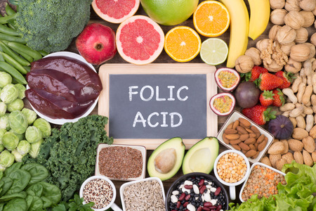 Folic acid food sources, top view on wooden background