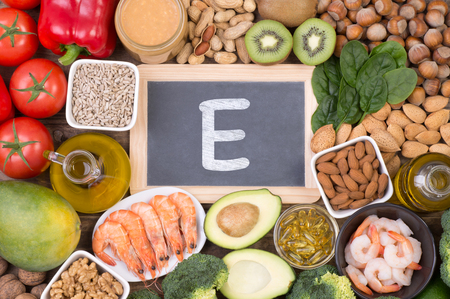 Vitamine E food sources, top view on wooden background