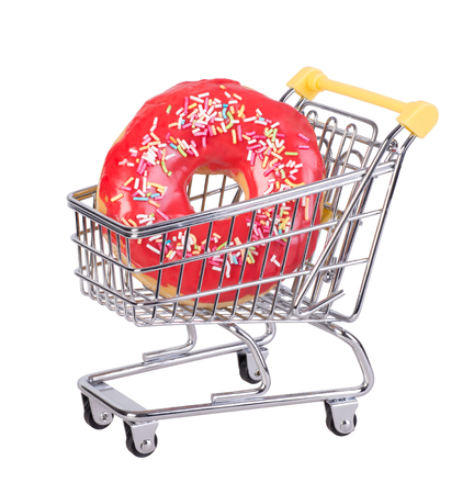 Donut in a shopping cart isolated on white background Stock Photo