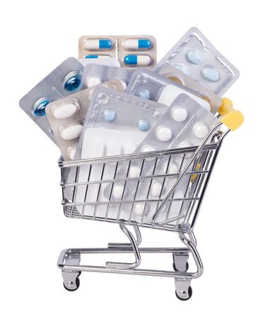 Medicines in a shopping cart, isolated on white background, health care cost concept Stock Photo