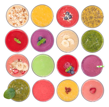 Fruit smoothies variety, top view, isolated on white background
