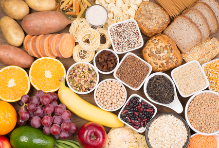 Food sources of carbohydrates, top view on a table