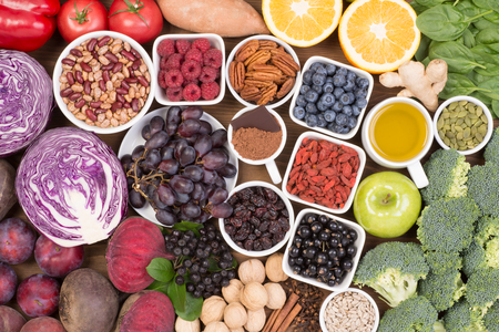 Food sources of natural antioxidants such as fruits, vegetables, nuts and cocoa powder. Antioxidants neutralize free radicals Stock Photo