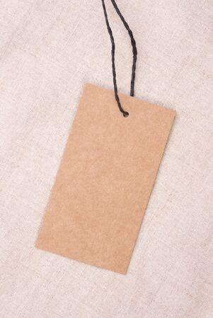 Blank price tags isolated on linen background