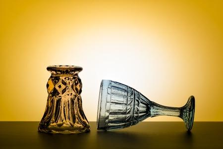 Vintage glasses for alcoholic beverages. Vintage composition. Studio.