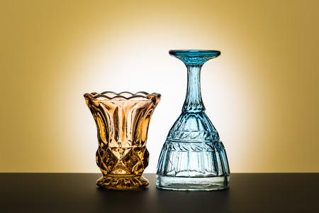 Vintage glasses for alcoholic beverages. Vintage composition. Studio photography.