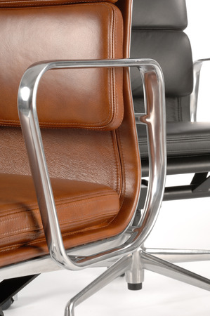 xx century: detail of two modern office chairs