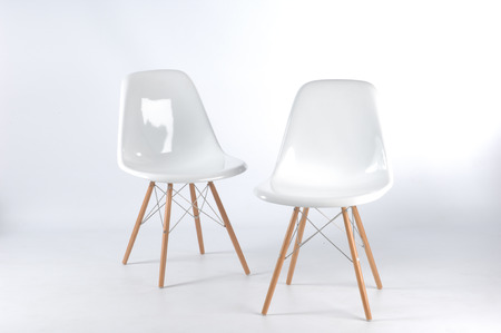 two modern white fiberglass chairs