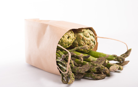 wild asparagus and artichokes in a paper bag