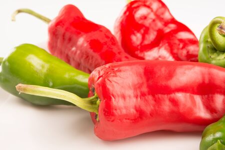 lycopene: red and green peppers on a white background