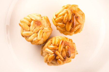 panellets: panellets, typical of Catalonia. Almond and pine nut pastries. traditional recipe Stock Photo
