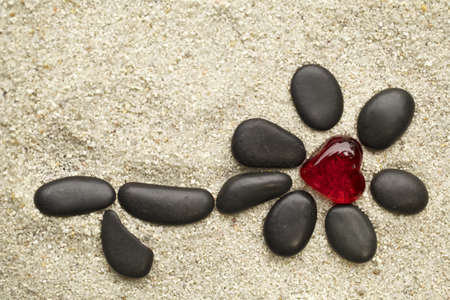 Flower of pebbles on the sand  photo