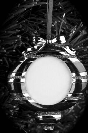 Black and white ,hanging round photo frame on Christmas tree background