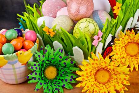 Easter decoration,eggs,candies and flowers on a background