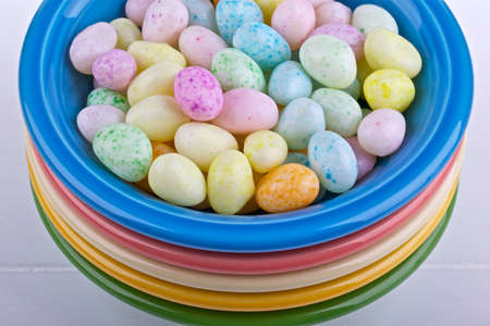 Colorful candies in a blue bowl 免版税图像