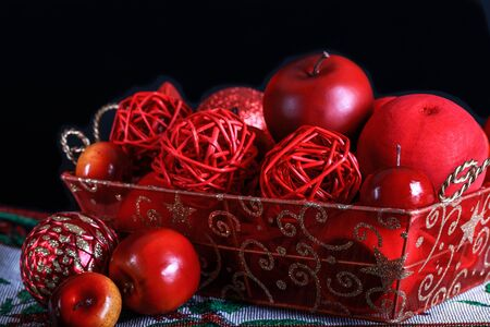 Christmas red decoration, in an ornamental basket.
