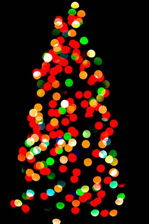 Christmas tree with colorful defocused lights, black background Stok Fotoğraf