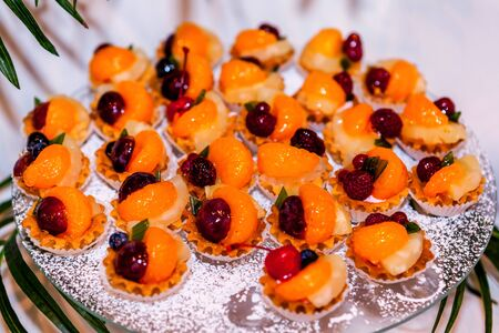 Tasty sweet snack, tangerine and various fruits