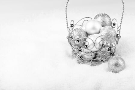Christmas decoration. Baubles in a decorative basket, black and white image.