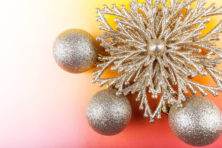 Christmas decoration, decorative star and three baubles on a colored background. Stok Fotoğraf