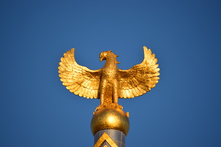 Astana, capital of Kazakhstan - Top of the Independence Column in the form of a golden eagle with spread wings Editorial