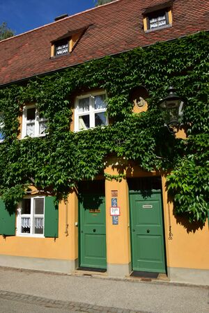 Augsburg, Germany - The historical FUGGEREI - the first social housing district of the 16th century Editorial