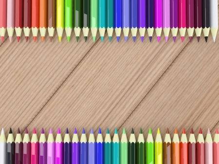 Frame by colorful pencils on wood table background photo
