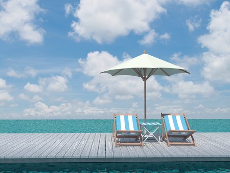 view of two chairs and white umbrella on the wood pier on the shore near the sea