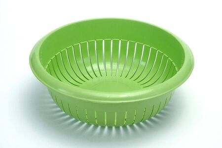 a colander: green colander Stock Photo