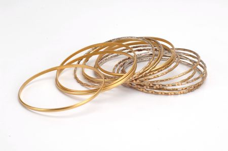 collet: gold bracelets isolated at white