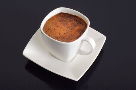 turkish coffee: a cup of coffee on black